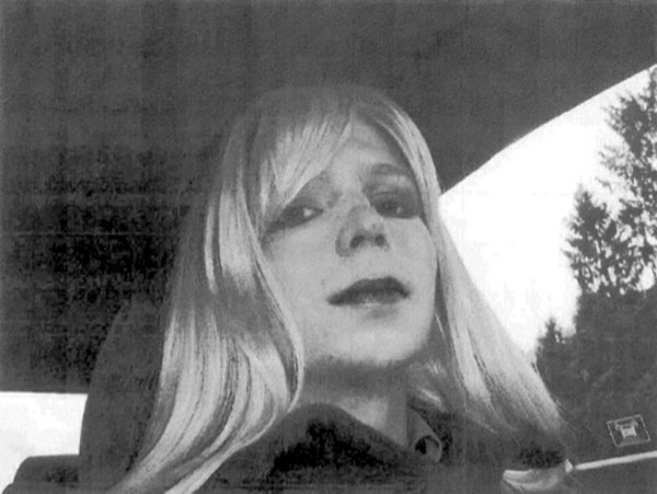 Manning in wig and lipstick.